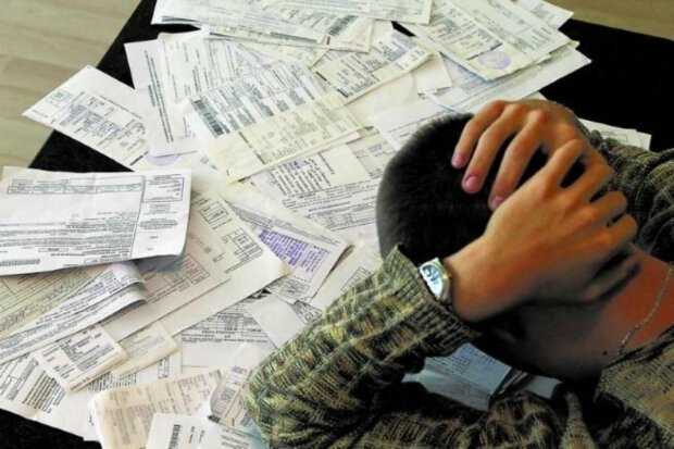 """Депутаты хотят заставить украинцев уплатить долги за коммуналку: что предлагают трое """"слуг"""""""
