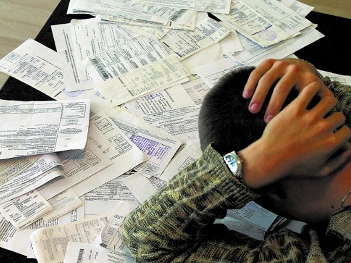 Борги за комунальні послуги будуть списувати з банківських карток українців автоматично